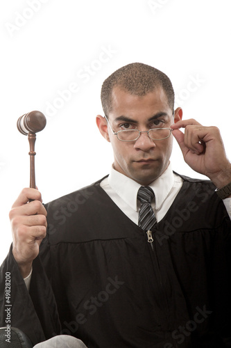 Attractive hispanic african american judge holding gavel