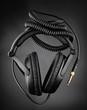 Modern headphones over dark background