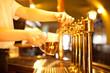 waiter is drafting a beer from a golden spigot - 49829256