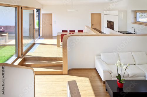 Beautiful new peaceful, modern living room with kitchen