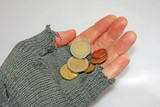 hand of the poor man who asks the charity to a few euros