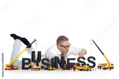 Business start up: Businessman building business-word.