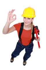 Female plumber giving the OK