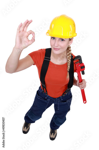 Female plumber giving the OK