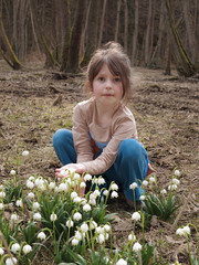 girl in the forest with flowering snowflake