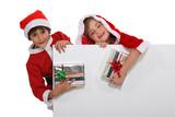 Children dressed as Santa Claus