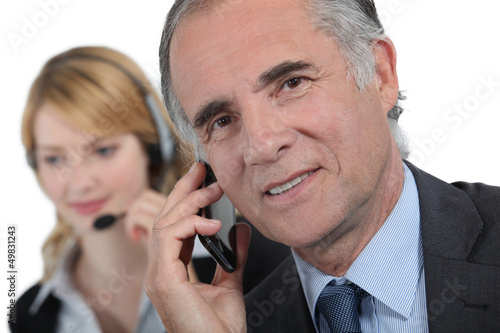 secretary and businessman working on the phone