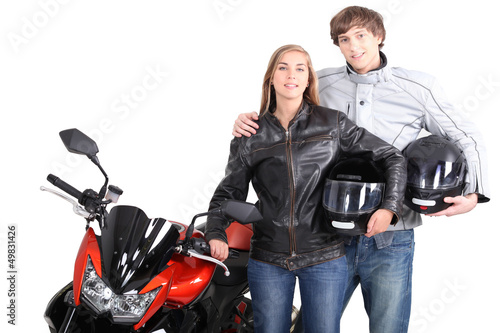 Couple stood with motorcycle
