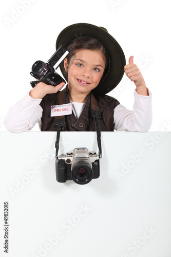 Young girl pretending to be a correspondent