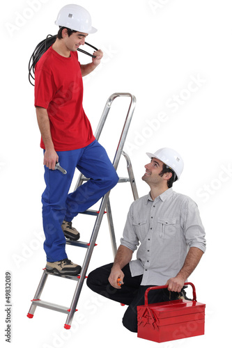 Team of electricians on white background