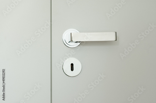 detail of white doors with chrome handle