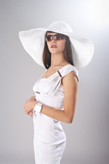 Fashionable lady in white clothes