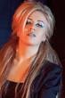 beautiful blonde girl rocker on a dark background