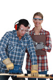 male and female joiners working together poster