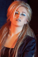 beautiful blonde girl rocker on a dark background