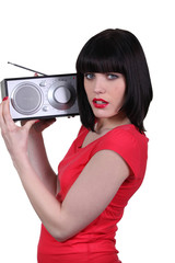 woman listening the radio