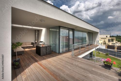 Leinwandbild Motiv timber pool deck on modern home terrace
