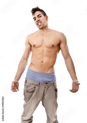 Arrogant fitness boy, in jeans.