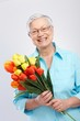 Grandmother with flowers smiling