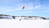 Winter Snowkiting on the ice lake
