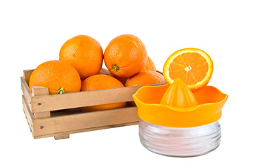 orange fruits in a wooden crate isolated on white background