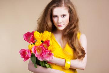 Beautiful redheared girl with tulips