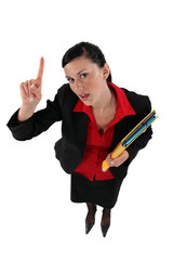 Woman holding folder asking a question