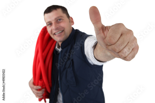 successful plumber with thumb up