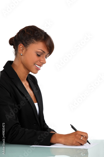 Woman sat at desk writing