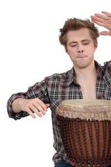 Man playing a djembe drum