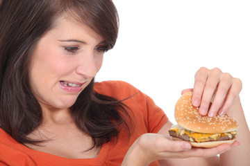 brunette looking at burger