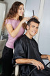 Mature Client Getting Haircut In Salon