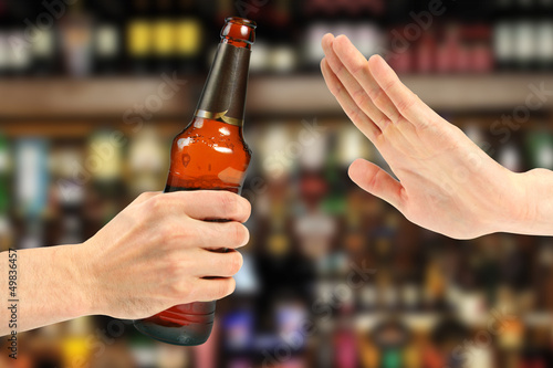 Deurstickers Bar hand reject a bottle of beer in the bar