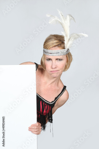 Woman in party dress holding marketing board