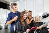 Hairdressers Setting Up Client's Hair In Salon