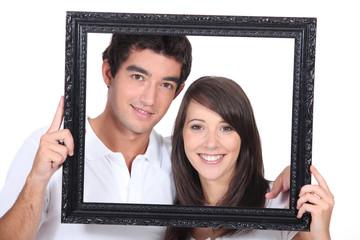 Teenagers holding photo frame