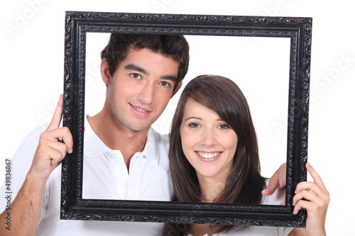 Teenagers holding photo frame