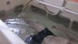 Man is having leg massage in a bath