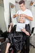 Woman Reading Magazine While Having Haircut