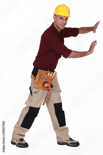 Construction worker pushing empty copyspace
