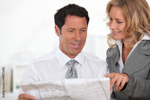 business partners looking at plans
