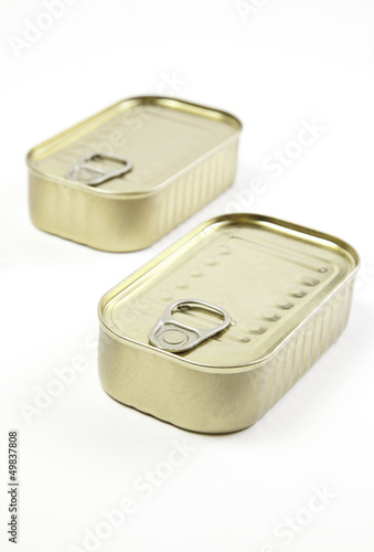Unopened cans of sardines