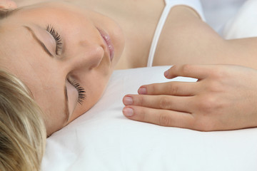 Blonde woman sleeping serenely