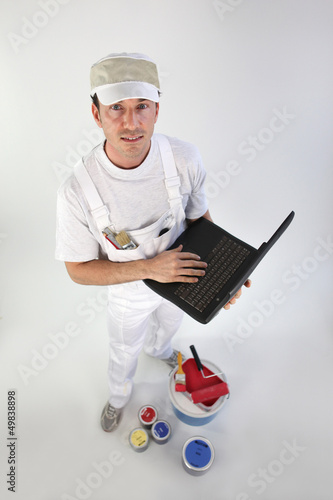 High-angle shot of a painter using his laptop
