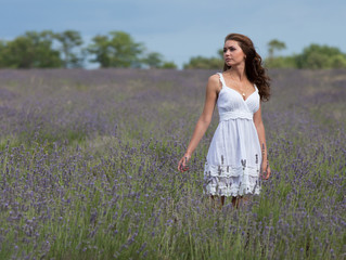Young woman in white outdoors