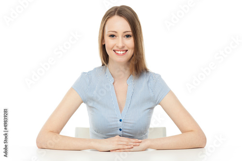 Young woman leaning arms on table