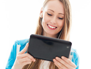 Female teenager using digital tablet