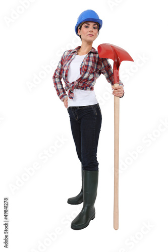 Proud construction worker with a shovel