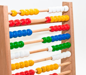 Close view of an abacus with colored beads.