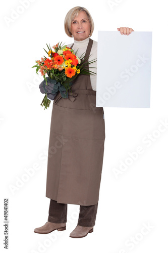 Florist with a bouquet and a board left blank for your message